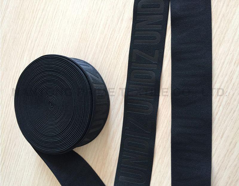 Jacquard shiny black elastic -- Manufacturer